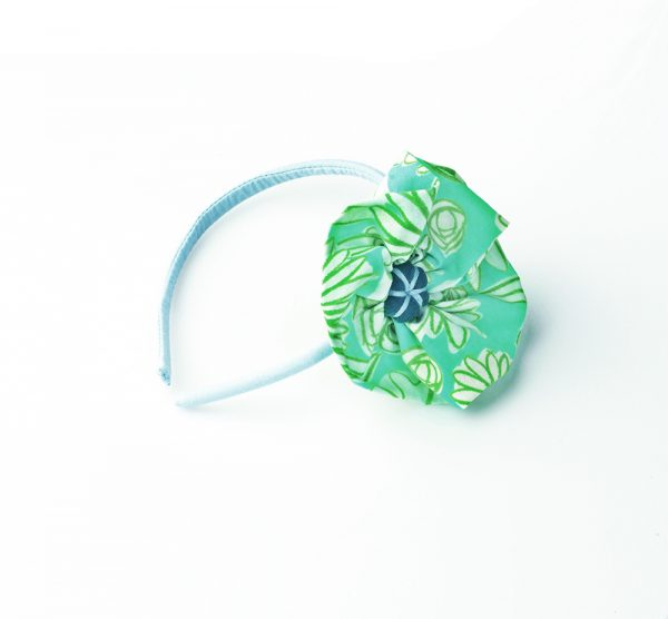 Diadema de flor en color verde agua